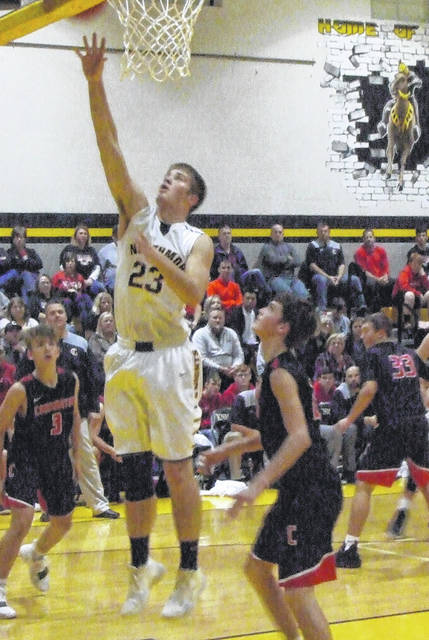 Northmor's Blake Miller works inside for a lay-up in Friday's win over Cardington.