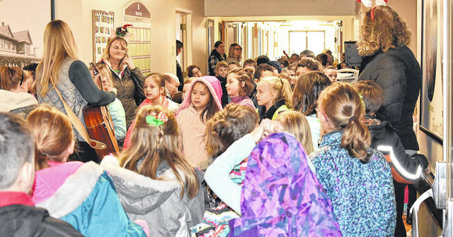"""Courtesy photo Galion Primary School students and staff visited nursing homes in Galion to spread holiday cheer last week."""""""
