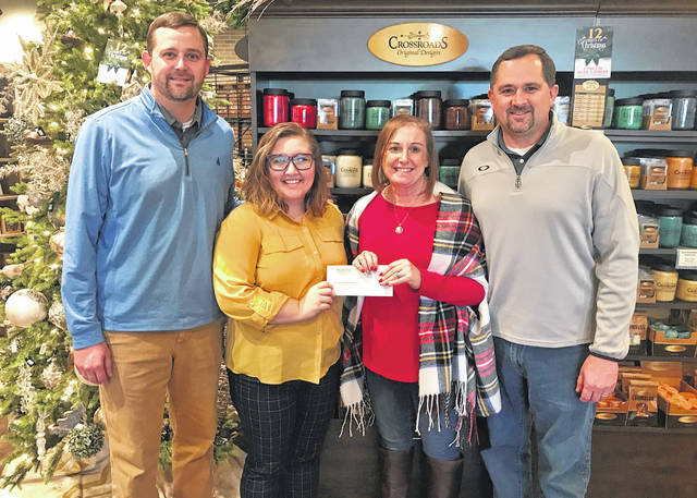 Courtesy photo From the left: Justin McMullen, Nadia Oehler, Erin McMullen and Jason McMullen. The McMullens recently gave Oehler, director of United Way of Crawford County, a donation of more than $14,000.
