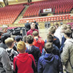 Pointers from an expert: GHS' Nate Reinking speaks to middle school baskeball players.]