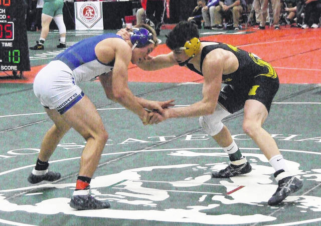 Northmor's Tony Martinez (r) claimed a 14-1 win over Andrew Halko of Bishop Ready to clinch a spot on the podium in the 145-pound class at the state wrestling meet. He would finish sixth.