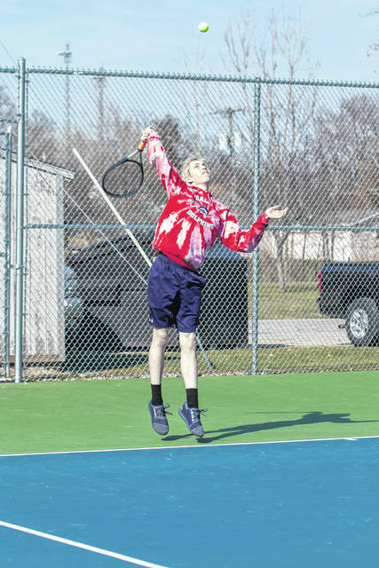 Erin Miller | Galion Inquirer Galion's Weston Rose looks to serve up an ace during Tuesday's doubles matchup with partner Alec Dicus. Unfortunately, Rose and Dicus would fall in three sets to their Harding opponent as the Tigers suffered their first loss of the season; 4-1.