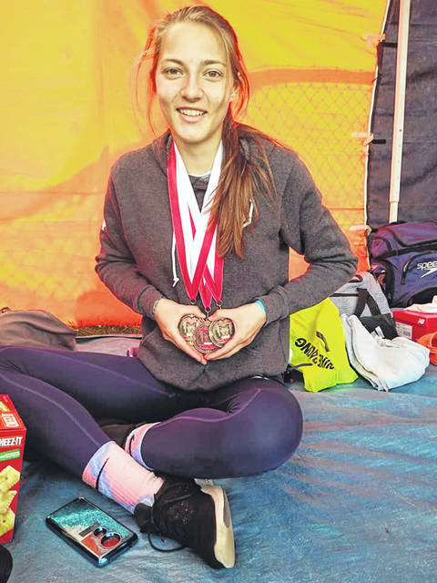 Submitted photo Kerrigan Myers poses with her three medals from the Mansfield Mehock Relays. Myers claimed gold in both the 100-meter hurdles and the high jump and was also part of the Galion squad that ran their way to third place in the 4x100-meter relay on Saturday.