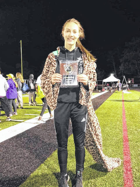 Submitted photo Kerrigan Myers poses with her MVP plaque following her performance at the 70th Marion Night Invitational. Myers won the 100 and 300-hurdles as well as the long jump to tally 30 points for the Galion Lady Tigers. Myers was also a part of the 4x100-meter relay team that earned third place.