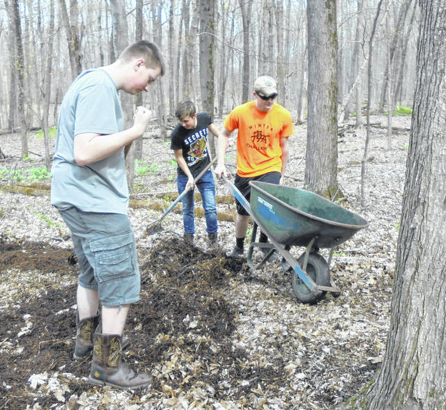 Courtesy photo Students were busy filling the wheelbarrows for the trails in the woods.