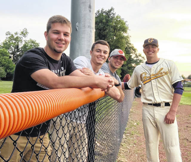 Submitted photo Galion alumni Garrett Kuns, shown here with support from fellow Tigers Ryan Talbott, Mitch Dyer and Ethan Pigg, played a crucial role in the Graders' win on Tuesday at home against the Muskegon Clippers. In that contest, Kuns ripped a single and a double, netted three runs batted in and stole a base as Galion won by a final of 4-2.
