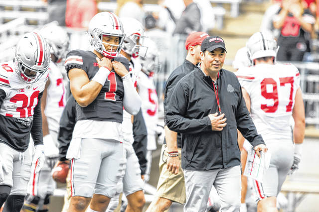 Levi A. Morman | The Lima News Ohio State's Justin Fields (1) and Head Coach Ryan Day observe the offense ahead of the Spring Game on Saturday, April 14 in Columbus.