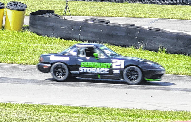 John Guthrie of Sunbury takes part in the Mazda Miata Heritage Cup at Mid-Ohio's Vintage Grand Prix. Guthrie would finish fifth in that race on Saturday and take third on Sunday.