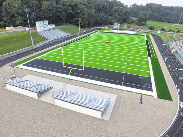 Turf being laid at the Colt Corral last week in preparation for the fall sports season.