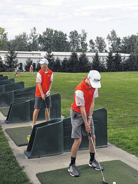 Submitted photo The Galion Tigers junior varsity golf squad warming up at the range ahead of their match on Thursday against the Upper Sandusky Rams. The jayvee team was defeated by Upper while the varsity team won by eight strokes. 164-172.