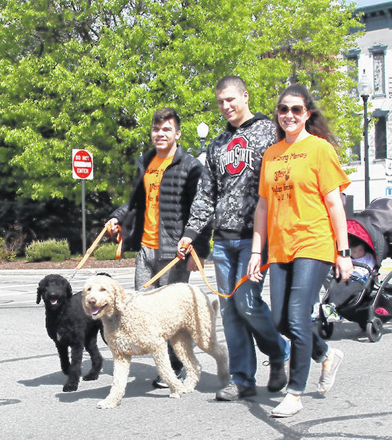 Crawford-Marion ADAMH Board More than 120 people, including some in strollers and a few four-legged friends, participated in the 15th Crawford County Walk for Suicide Prevention on May 11 in downtown Bucyrus to help raise money and awareness for suicide prevention.