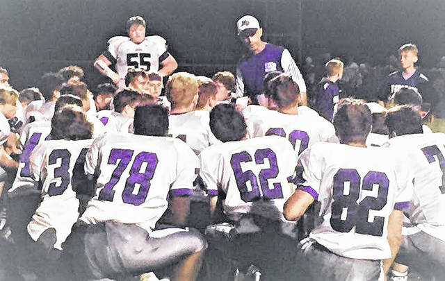 Mount Gilead head coach Phil Mauro talks to his team after its 31-0 loss at Colonel Crawford Friday night.