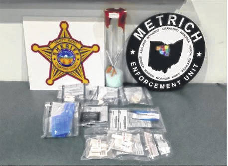 Courtesy photo These items were confiscated last week as local law enforcement made an arrested in the 800 block of East Mansfield Street in Bucyrus.