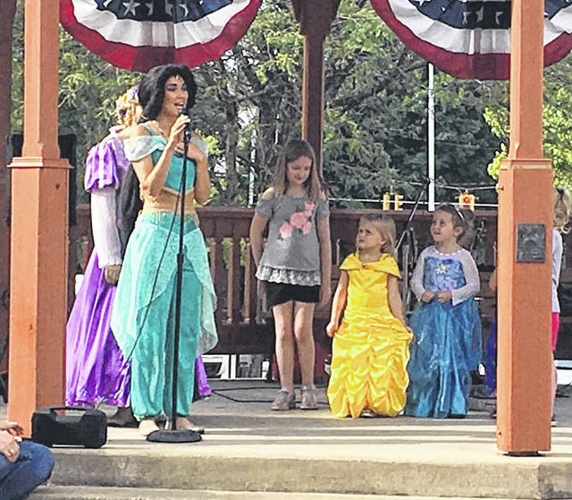 Photo by Jodi Myers The singing Princesses were a hit once again at Third Friday in Galion. They invited little princesses up to the gazebo and let them sing along with them. The Princesses are a group of local girls who dress up as Disney princesses, and their little fans followed suit.