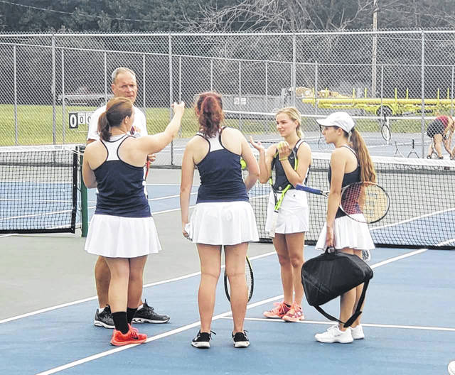 Chad Clinger | Galion Inquirer New head coach of the Galion Lady Tigers tennis program Terry Gribble speaks to members of his squad ahead of their season-opening match with Willard on Monday. Galion lost for the first time in dual action since 2016, 4-1.