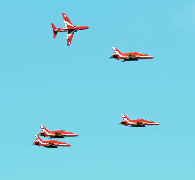 The Royal Air Force jet team, the Red Arrows begin their break-away for landing over Dayton International Airport on Thursday afternoon.