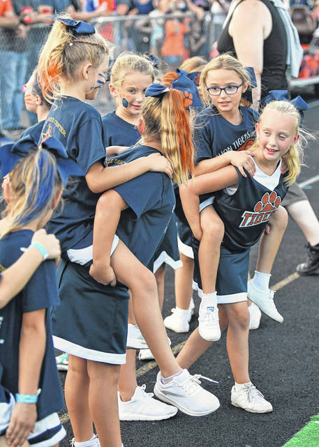Photo by Don Tudor Elementary school students from all over Galion were the focus of the pregame show Friday night at Heise Park Stadium. These kids hitched on the back of some other students on the track. All of the kids were introduced to the Tigers' faithul before the game. The game was called before halftime due to a thunderstorm. The Tigers won 42-0.