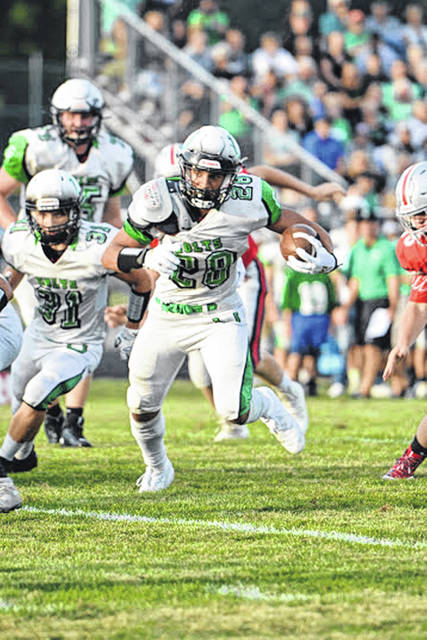 Photo by Jeff Hoffer  Clear Fork running back Elijah Hughes finds a hole during first-half action at Fredericktown. Hughes started the Colts' scoring barrage with an early 13-yard TD run.