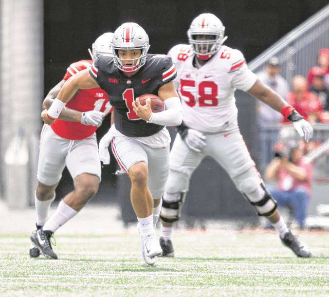 Ohio State Quarterback Justin Fields finds a gap and makes a break-away down the field on Saturday afternoon.    Levi A. Morman | The Lima News