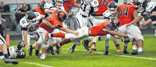 Don Tudor | Galion Inquirer Galion senior Isaiah Alsip lays out for a three-yard touchdown run during Friday's contest with the visiting Carey Blue Devils. Alsip would run, catch and throw for a touchdown, as well as record an interception as the Tigers moved to 2-0 with the 35-6 victory.