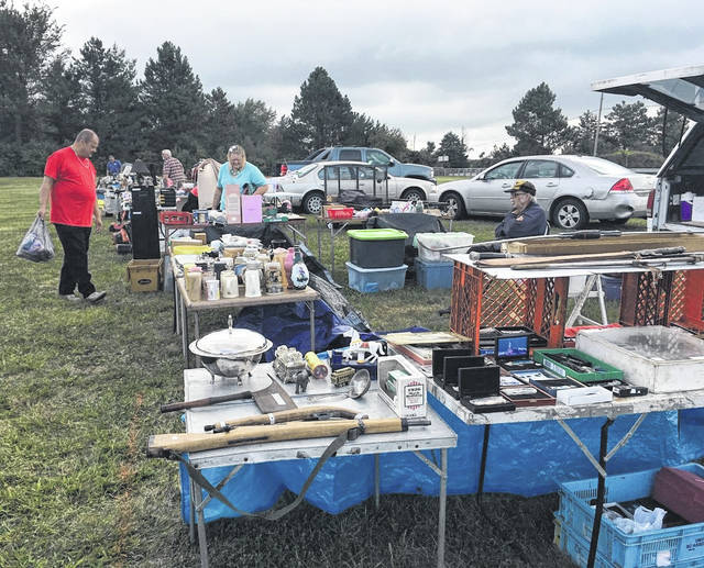 Photo by Jodi Myers A car show and flea market Saturday in Bucyrus is the largest fundraiser each year for Community Counseling Services. On sale at the flea market were anything from items for the home and antiques to car parts.