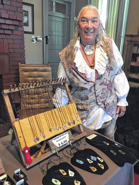 Photo by Jodi Myers. Native American historian Roger Moore was one of the more popular people to visit during an EMP (Exposition of the Mystical and Paranormal) at Brownella Cottage on Saturday.