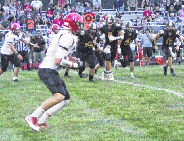 Cardington's Trey Brininger heads up the field after hauling in a Nate Hickman pass against Colonel Crawford pass.