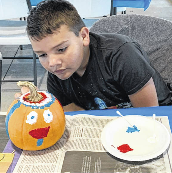 Photo courtesy Miranda Jones Reilly McCane shows off the pumpkin he painted Saturday during the Fall Festival presented by Friends of the Big Four Depot. It included food, music, entertainment and crafts. Next year, organizers are hoping for warmer weather and are planning to add more events.