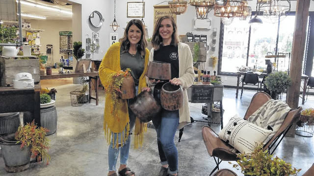 Photo by Louise Swartzwalder Mikayla Knox with Whitney Smith in the Rustik Market that opened in a new addition to True Value Hardware in Bellville.