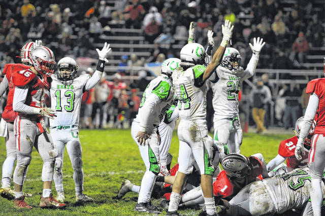 Clear Fork players celebrate a second-half touchdown against Shelby. The Colts fell 35-25 and failed to make the playoffs.