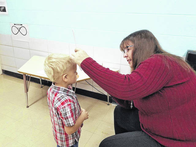 Courtesy photo Dr. Christina Fox performs an eye exam at Fairway Preschool in Bucyrus recently. This year, nine students out of 66 screened, were found to have vision concerns and recommendations were sent to their parents for further follow up.
