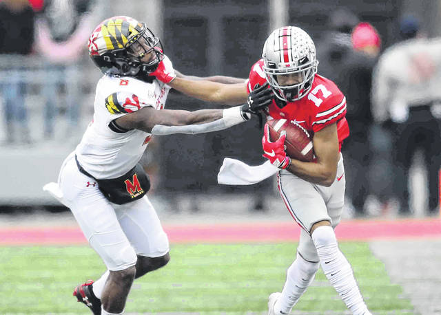 Ohio State's Chris Olave fights off Maryland's Keandre Jones during Saturday's game at Ohio Stadium in Columbus.