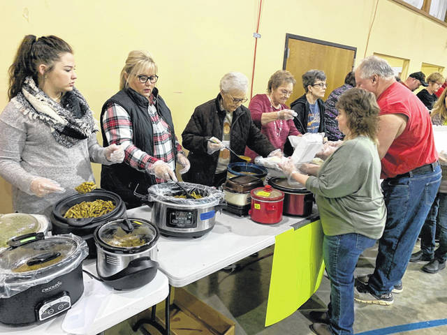 Photo by Jodi Myers Volunteers showed up by the dozens Thursday morning at Galion's Grace Point church. They prepped, dished up and delivered Thankstiving meals to more than 250 Crawford and Morrow county residents.