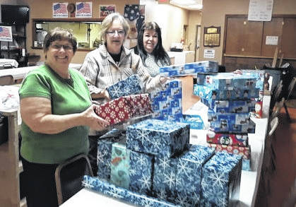 Russ Kent | Galion Inquirer Janet Hout, Jo Ann Baldwin and Jeanne Dunlap spent an afternoon this week wrapping gifts and doing other prep work for today's Christmas party at American Legion Scarbrough Post 243 in Galion. The women are all members of the American Legion Women's Auxiliary. They were wrapping gifts for more than 60 children expected at the party.