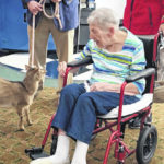 Four-legged friends from afar visit with Magnolia Terrace residents