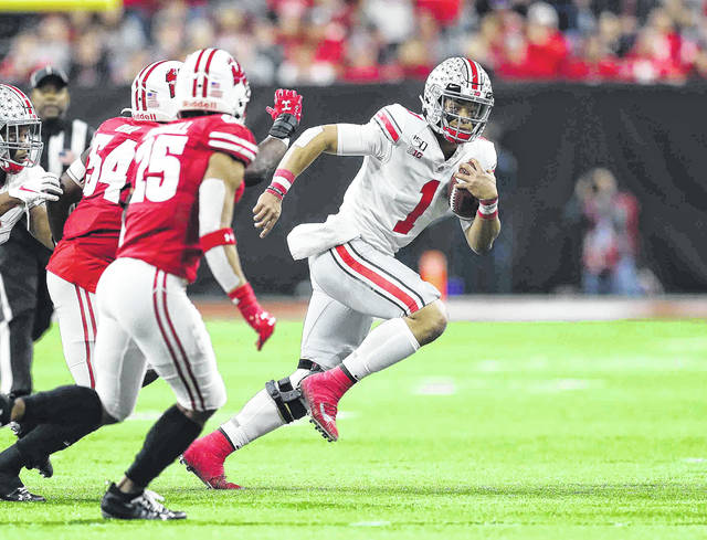 Ohio State quaterback Justin Fields, shown here against Wisconsin in the Big 10 Championship game, said he and Clemson quarterback Trevor Lawrence are friends.