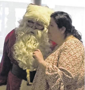 Courtesy photo  Peggy B. tells Santa want she wants him to bring her for Christmas at last week's Christmas Dinner at the Trillium Center in Bucyrus.