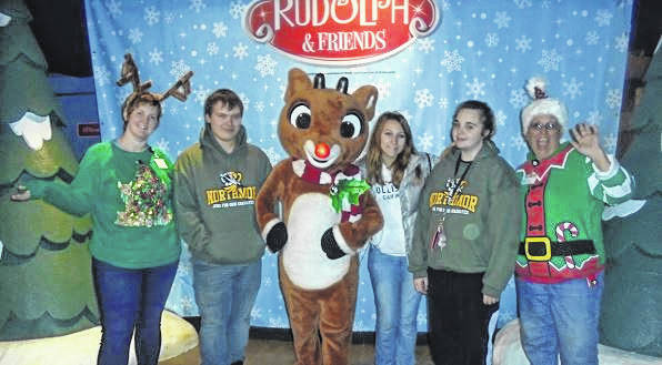 Courtesy photo  Northmor's Nick Cavanaugh, Olivia Carns and Lola Sackman visiting Rudolph and some elves.