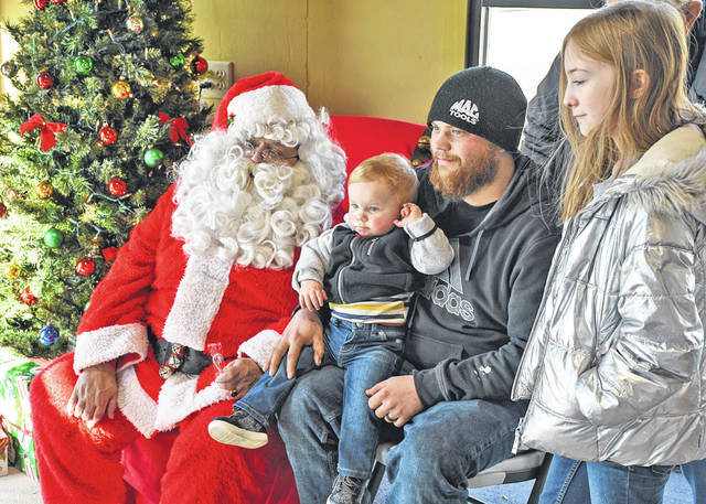 Nick Fruth visits Santa with Colt, 1, and Cali Lofts, 9, during Breakfast with Santa at Saturday's Come Home to Galion event. Photo by Don Tudor.