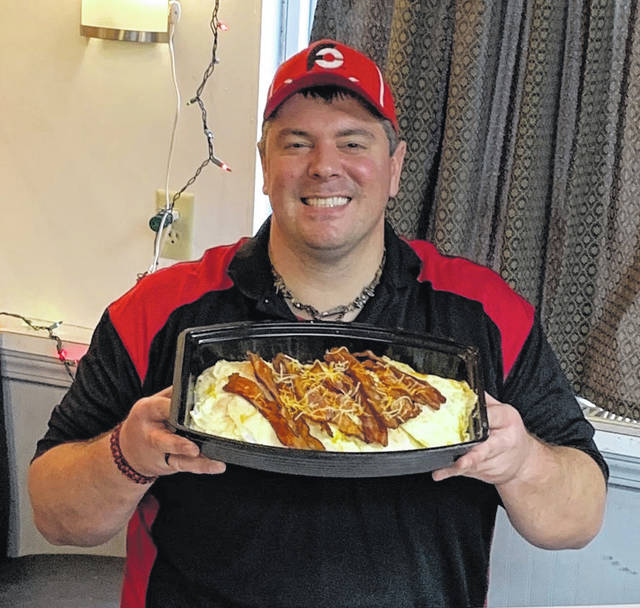 Photo by Jodi Myers' Professional eater Randy Santel was in Galion last Friday to take on the 'Risk it for the biscuit' food challenge at Granny's Kitchen on Ohio 309.