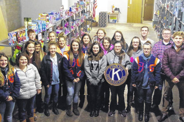 Courtesy photo This Christmas season, as in the past, members of the National Honor Society and Key Club at Galion High School, pitch in with local Kiwanis members to help parents shop for toys for their kids.