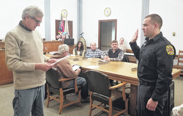 Courtesy photo   Galion Mayor Tom O'Leary swears n new Galion firefighter Aaron Barnhart on Tuesday night during the regular city council meeting. Barnhart is a Galion graduated and Chief Phil Jackson said Barnhart was the first Galion native hired as a result of recruitment efforts at Galion City Schools and elsewhere.