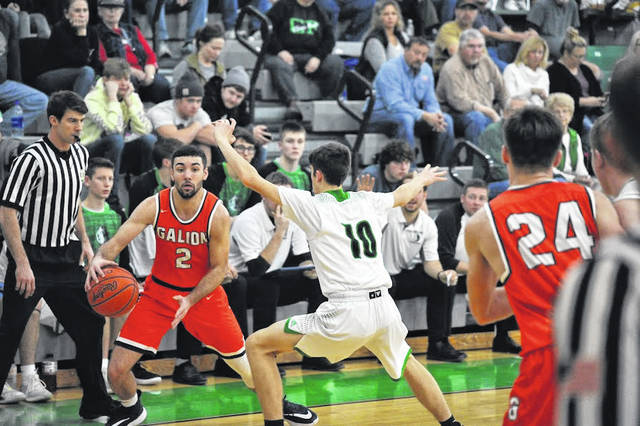Photo by Jeff Hoffer Clear Fork's Luke Labaki weaves his way through a bunch of Galion defenders Thursday during MOAC boys basketball action in Bellville. The Colts held the Tigers to just 18 points in the last three quarters into a 69-32 victory.