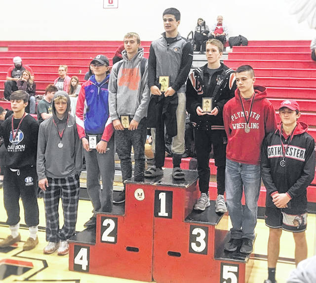 Submitted photo Galion junior Devin McCarthy (top, left podium) wrestled his way to a runner-up finish in the 132-pound weight class at the 49th Annual Marion Harding Classic last weekend.