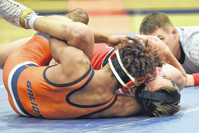 Don Tudor | Galion Inquirer   The referee looks on as Galion's Ian Lehman continues his pinfall attempt. Lehman, wrestling for the Tigers at 138-pounds, earned a pinfall victory against his Pleasant opponent in just 57 seconds.