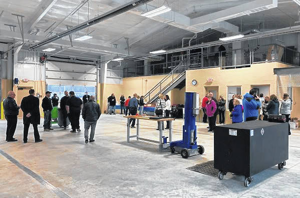 Photo by Jodi Myers Visitors and participants in a ribbon-cutting ceremony at the new Galion City Schools bus garage check out the interior of the building that Galion superintendent Jim Grubbs calls a state-of-the-art facility.