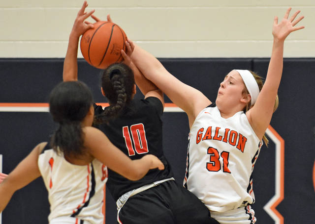 Photo by Don Tudor While playing defense, Galion sophomore Emma Jutz slaps the ball away from a Fostoria player during Tuesday's game at Galion High School. Fostoria won the game, 61-54.