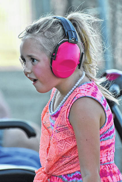 Photo by Don Tudor This Young fan as well-prepared for the roar of engines at last yea OSTPA tractor pull at the Crawford County Fair Her seat along the fence was one of the best … and one of the noisiest. See more fairs from the 2019 fair in our online galleries at www.galioninquirer.com