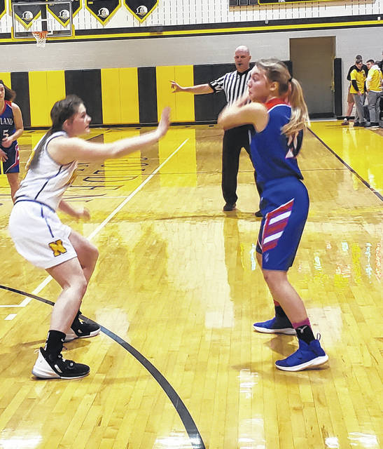 Brooklyn Baird looks for a teammate to pass the ball to in her team's Saturday win at Northmor.