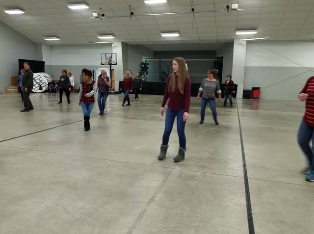 Photo by Louise Swartzwalder Line dancers from the Bellville area get in some practice Sunday at New Life Church. The classes are only $1 and proceeds benefit the Opera House.